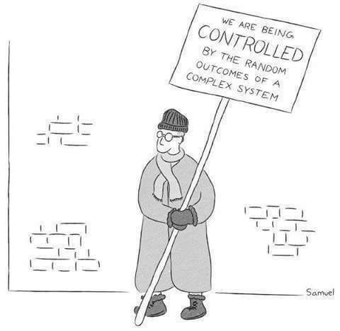 "Mann mit Schild auf dem steht: ""WE ARE BEING CONTROLLED BY THE RANDOM OUTCOMES OF A COMPLEX SYSTEM"""